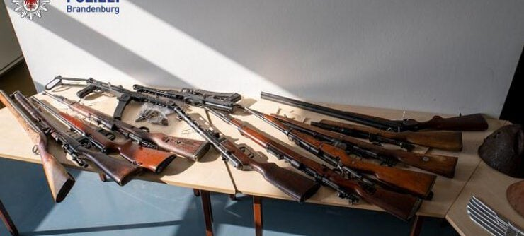 German police find human remains in raids against weapons dealers